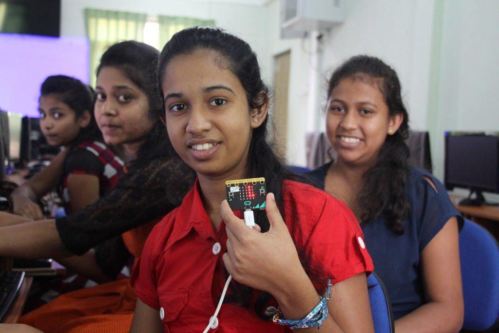 Sri Lankan girls in the classroom holding a Micro Bit