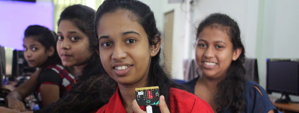 Sri Lankan girls in the classroom holding a Micro Bit