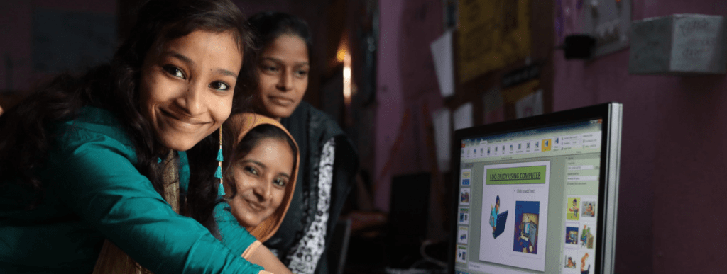 Young women around a computer in Patna, Bihar, India